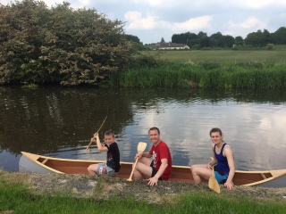 Chris canoeing with Joel and Charlotte